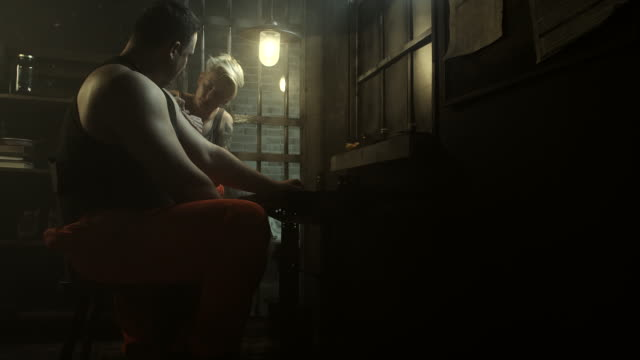 Women tattoing men at prison video