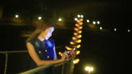Women texting on the smartphone at night video