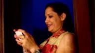Women typing on smart phone video