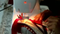 women used sewing machine video