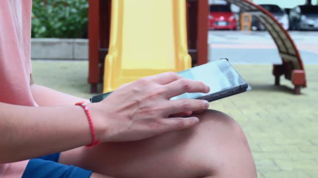 Women using digital tablet outdoors ,4k video