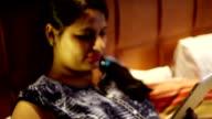 Women using ipad in hotel room video