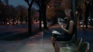 Women using phone at bus stop video