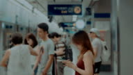 Women using smart phone at subway station video