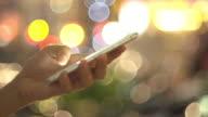 Women using smart phone defocused video