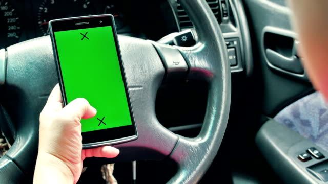 women using smart phone in the car, Green screen video