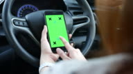 Women using smart phone in the car with Chroma key video
