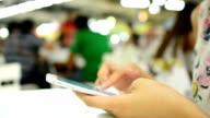 Women using smartphone in restaurant video