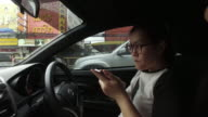 Women using smartphone while driving video