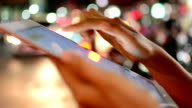 Women using tablet, night video