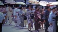1972: Women walking to a function in tradional Japanese kimodo dress. video