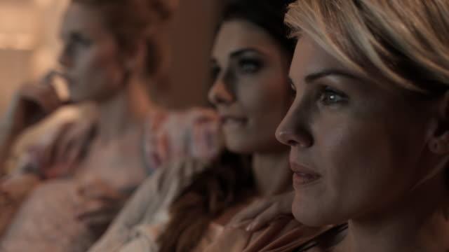 Women watching TV video
