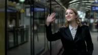 women waving hand goodbye farewell video