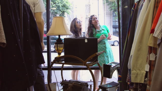 Women Window Shopping Outside Vintage Clothing Store video