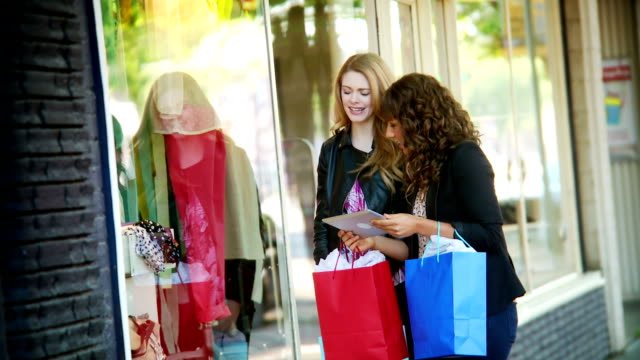Women window shopping with tablet video