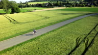 Women with electric bicycle aerial shot video