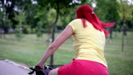 Women with red hair start drive bicycle video