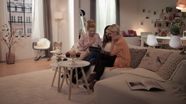 Women with tablet pc on couch video