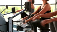 Women working out on rowing machine video