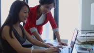 Women Working Together Comfortably video