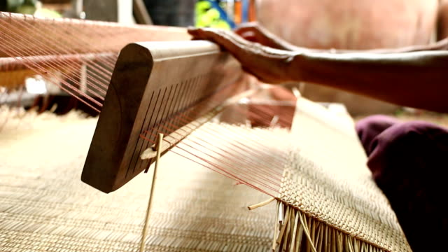 Women working weave mat video