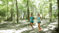 Womens' fitness club running off road together in park video