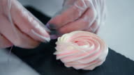 Women's hands are decorated meringue with stick and to tie the ribbon video