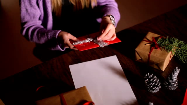 Women's Hands Wrapping Christmas Gifts At Home video