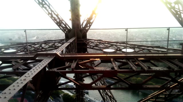 Wonderful view of Paris from moving Eiffel Tower lift in sunrise or sunset light video