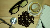 Wood desk and office supplies with coffee. video