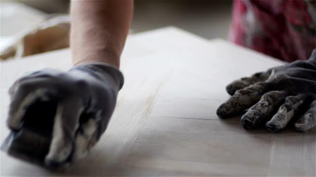 Wood panel hand sanding video
