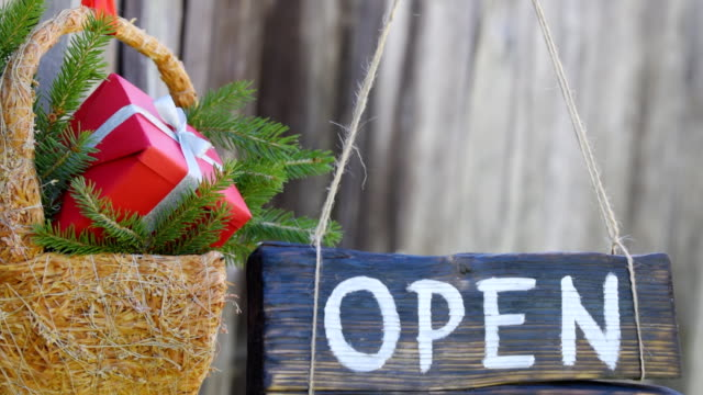 Wood sign with christmas decoration over grey wall video