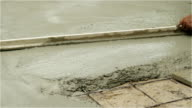 Wood trowel to smooth wet cement floor video