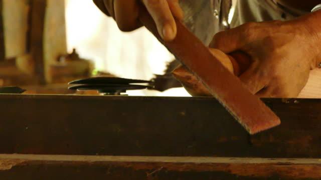 Wood turners using sandpaper polished wood video
