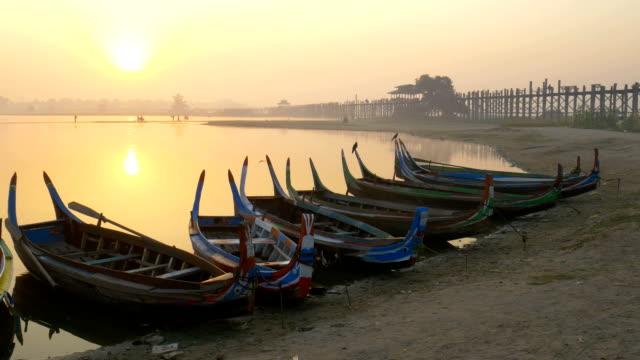 Wooden boat in Ubein Bridge at sunrise, Mandalay, Myanmar video