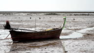 Wooden boat on the beach at low tide video