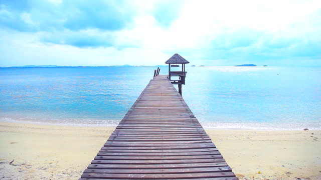 Wooden bridge that leads to the sea. video