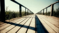 Wooden bridge to the river. Dolly. Close up video