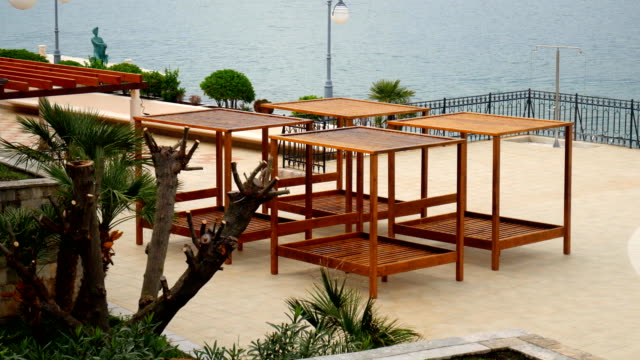 Wooden chaise lounges by the sea. Hotel in Kotor Bay in Monteneg video