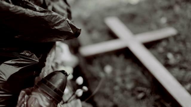 Wooden cross, graveyard dustbin video