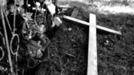 Wooden cross, graveyard dustbin video