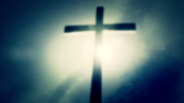 Wooden Cross on a Misty Sky Background video