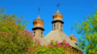 Wooden domes of Orthodox churches with crosses closeup video