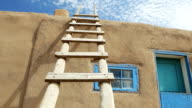 Wooden Ladder Against Adobe Building video