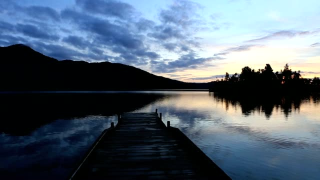 Wooden pier lying on lake Kaniere, South Island, New Zealand video