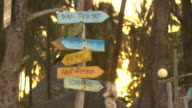 CLOSE UP: Wooden signs showing distances to major countries and cities video