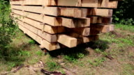 Wooden squared timbers for the building of wooden house video