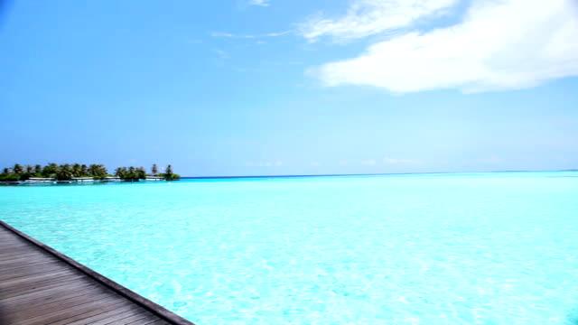 Wooden walkway on tropical Maldivian resort. video