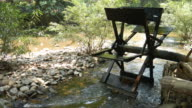 Wooden water turbine in the river video