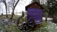Wooden wheel by beehive, time lapse video